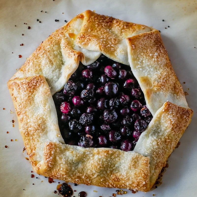 blueberry galette after baking on parchment paper