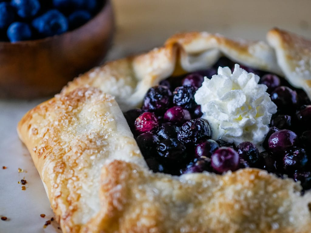 blueberry crostata with whipped cream on top