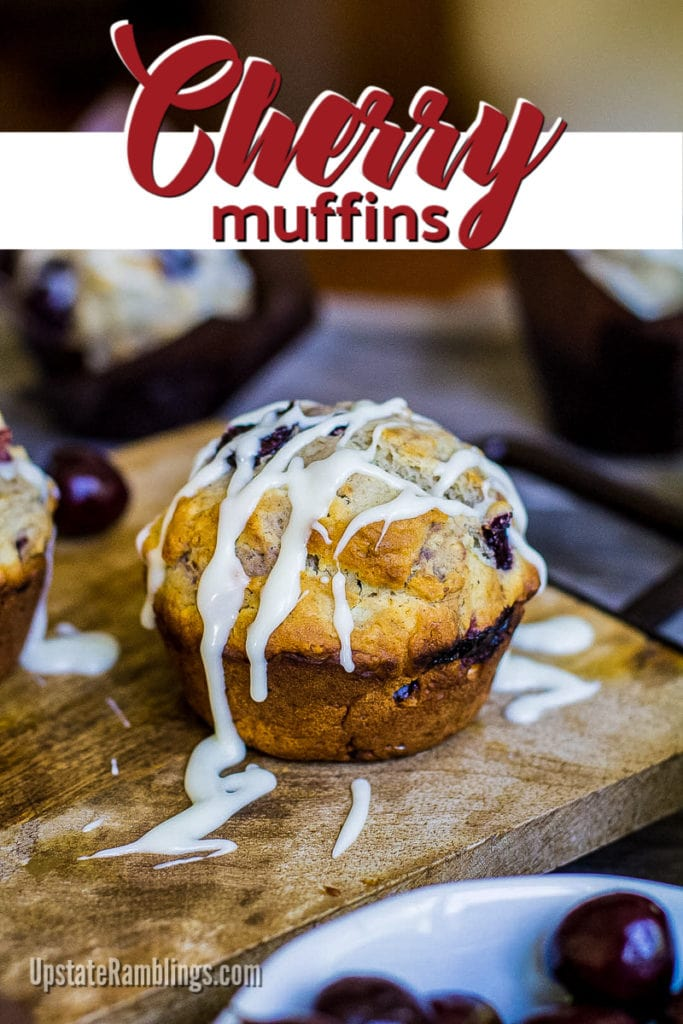 Cherry muffin with vanilla glaze on a wooden cutting board