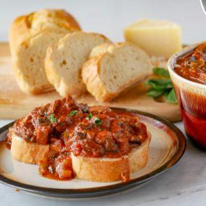 plate with mushroom stew on bread